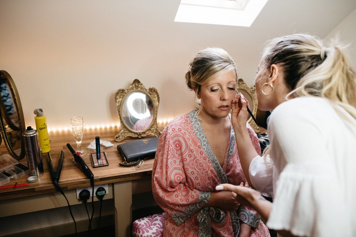Emily Grosvenor Bridal Makeup Artist working on a bride before her big day