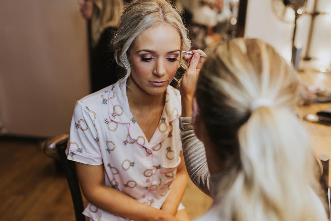 Action Photo of Emily Grosvenor Applying Wedding Day Makeup